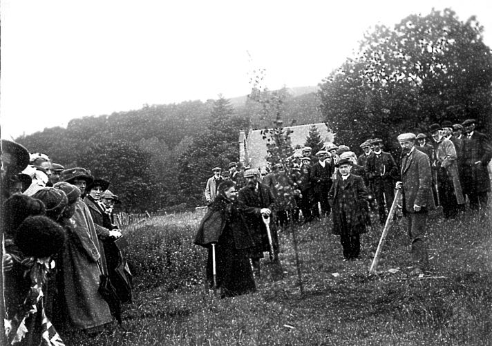 Mrs H Onslow tree-planting a memorial tree